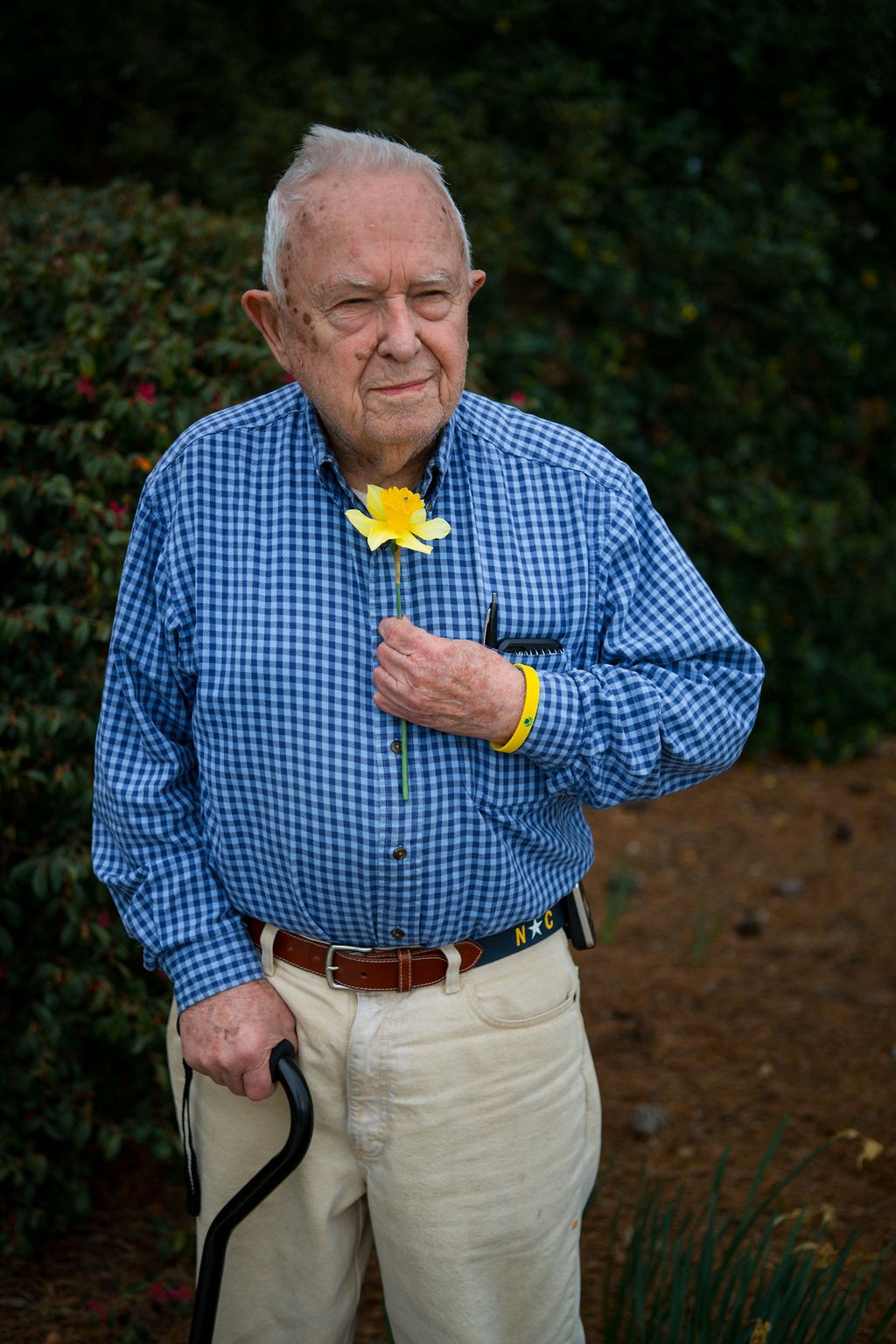 Old man with daffodil blossom